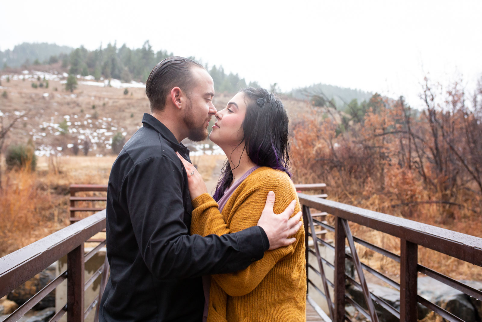 Rainy fall engagement photography  -the bridge at Lair O the Bear Park, Colorado