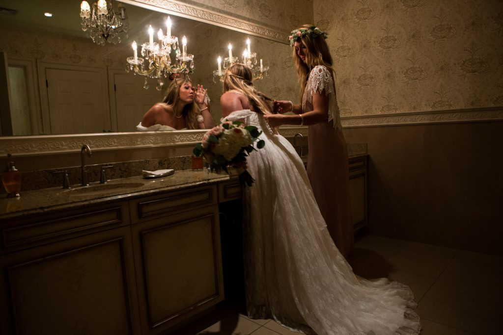 Sisters getting ready for the wedding at Lazy Swan Golf Course