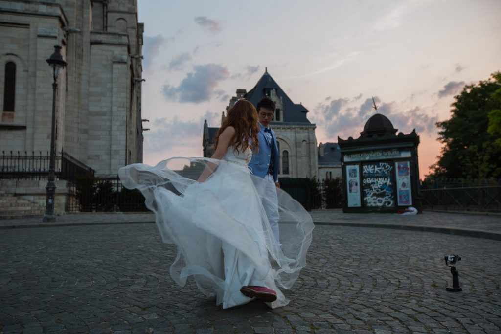 Couple dancing at sunrise at the Sacre couer in Paris