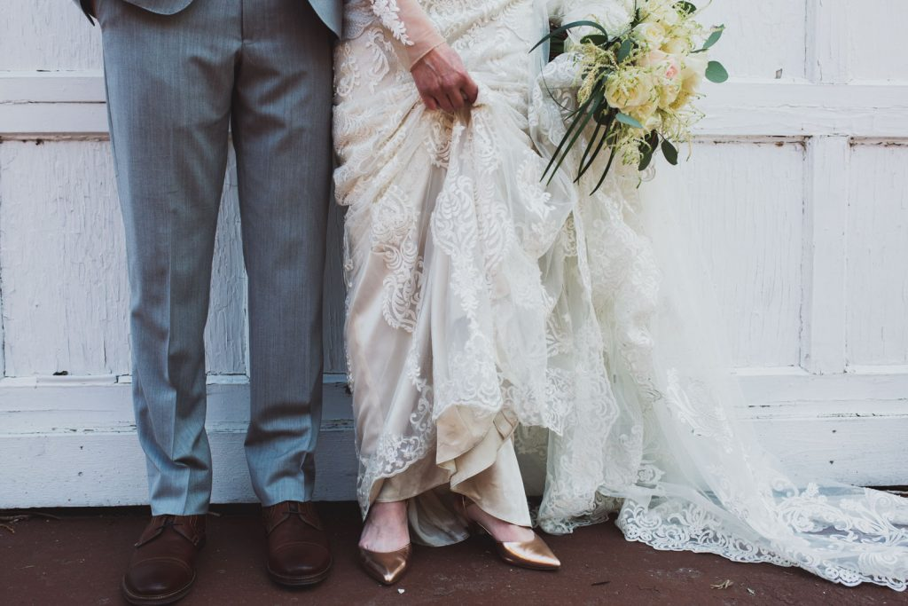 Bride and groom details , flowers and wedding gown